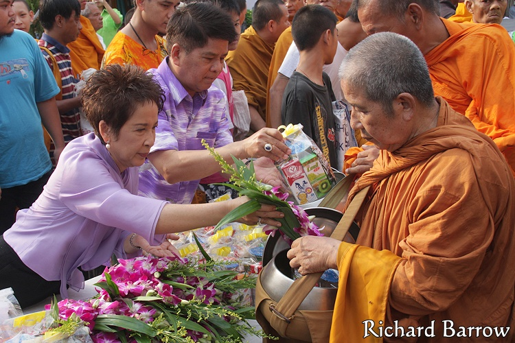 Offering Alms to Monks
