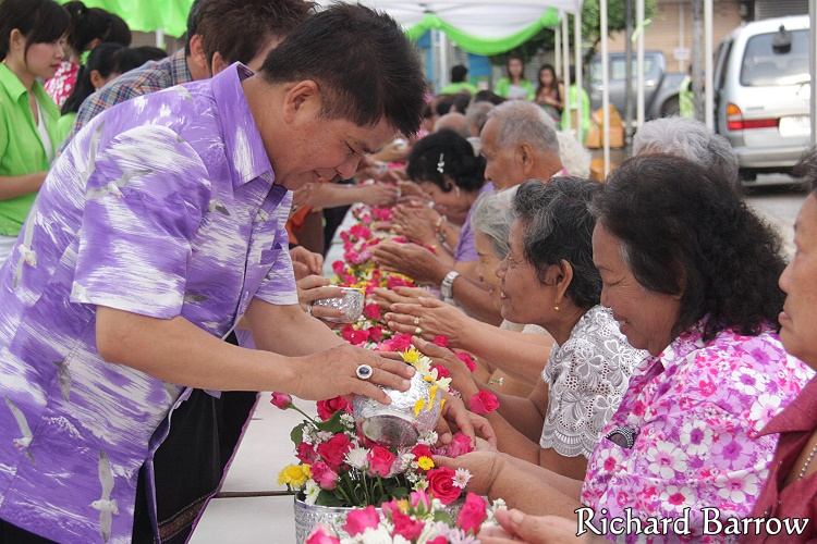 Pouring rose scented water on the hands of elders